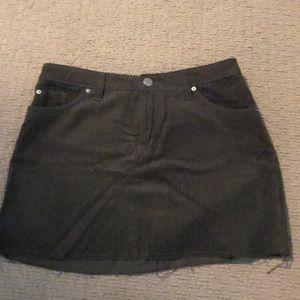 Green corduroy skirt with raw hem line